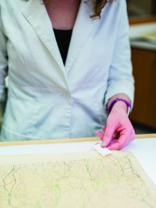 Historic map being restored.
