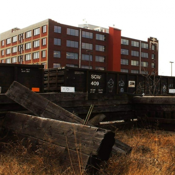 Gryphon Building & The Train Tracks. Photograph by Derrick Keeton.