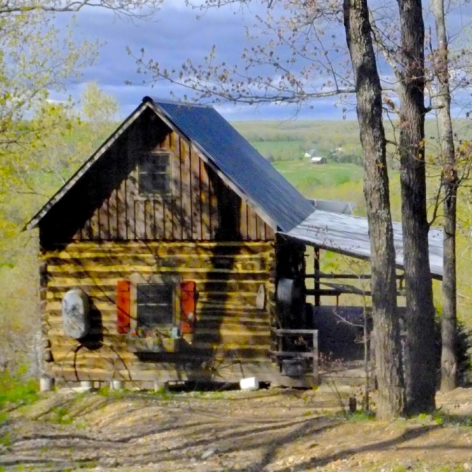 Ozark Cabin in Spring. Photograph by Tom Corey.