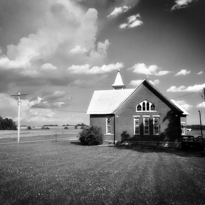 Country Church In May. Photograph by Lawrence Duffy.
