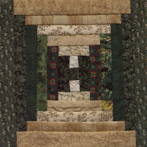 Courthouse Steps - Quilted by Debbie Wortman.