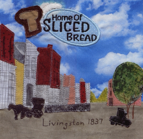 Slice of History - Created by Sherry Wohlgemuth in conjunction with Cuts and Bolts Fabric with embroidery applied by Avery McCauslin. **Selected for the Missouri Bicentennial Quilt**