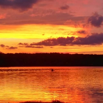 Indian Hills Lake Sunset. Photograph by Virginia Pope.